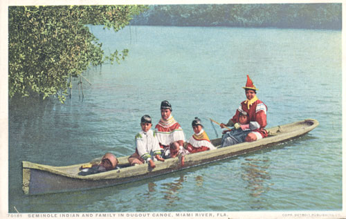 Seminole Indian family in dugout canoe