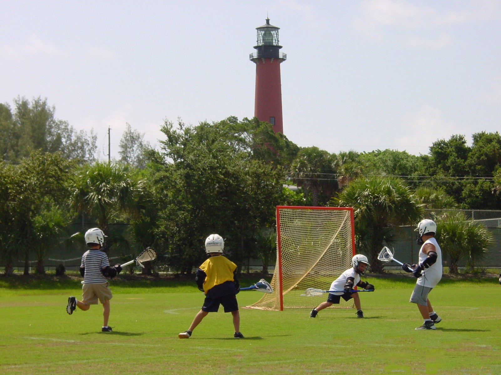 Soccer players near the lighthouse